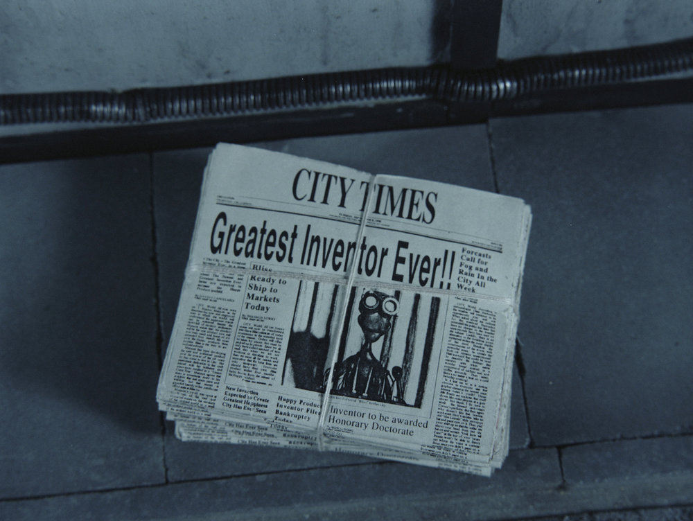 MORE_stills_013_newspapers.jpg