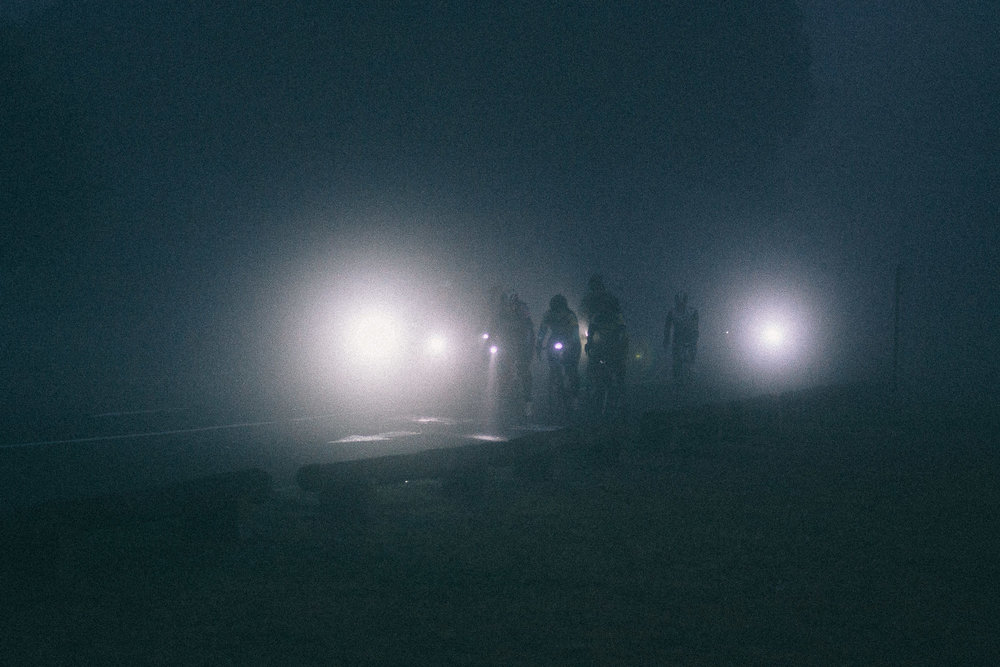 bicyclists in the fog