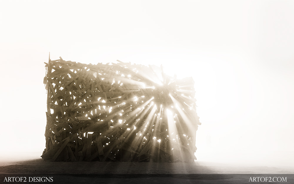 A wooden sculpture at Burning Man during a sandstorm