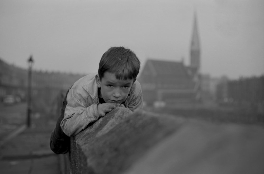 Boy on Wall, Harrow Road, London, 1963 - from The Child Poverty Series