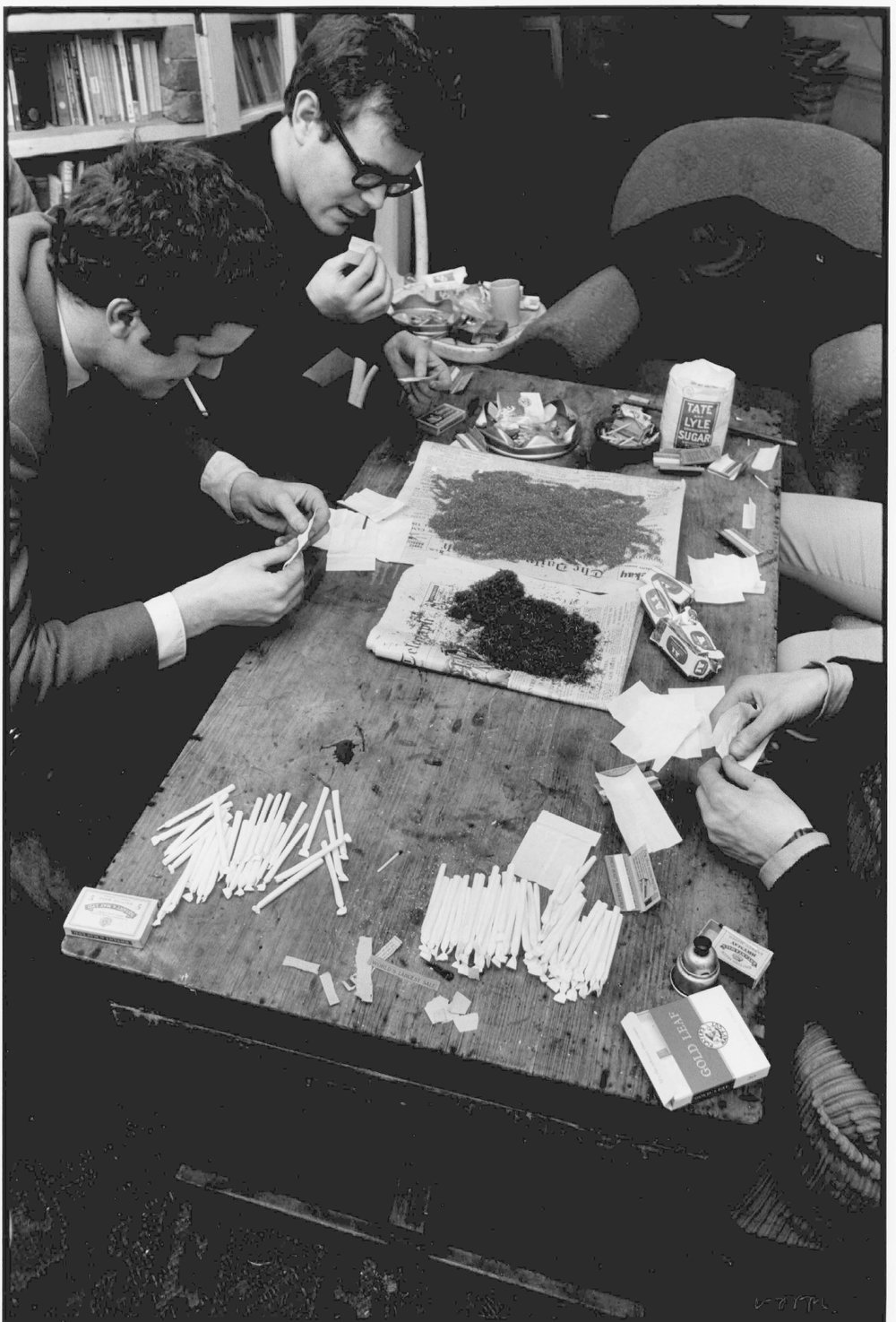 Joint Factory: Rolling Marijuana joints ready for a Party, London, c.1964