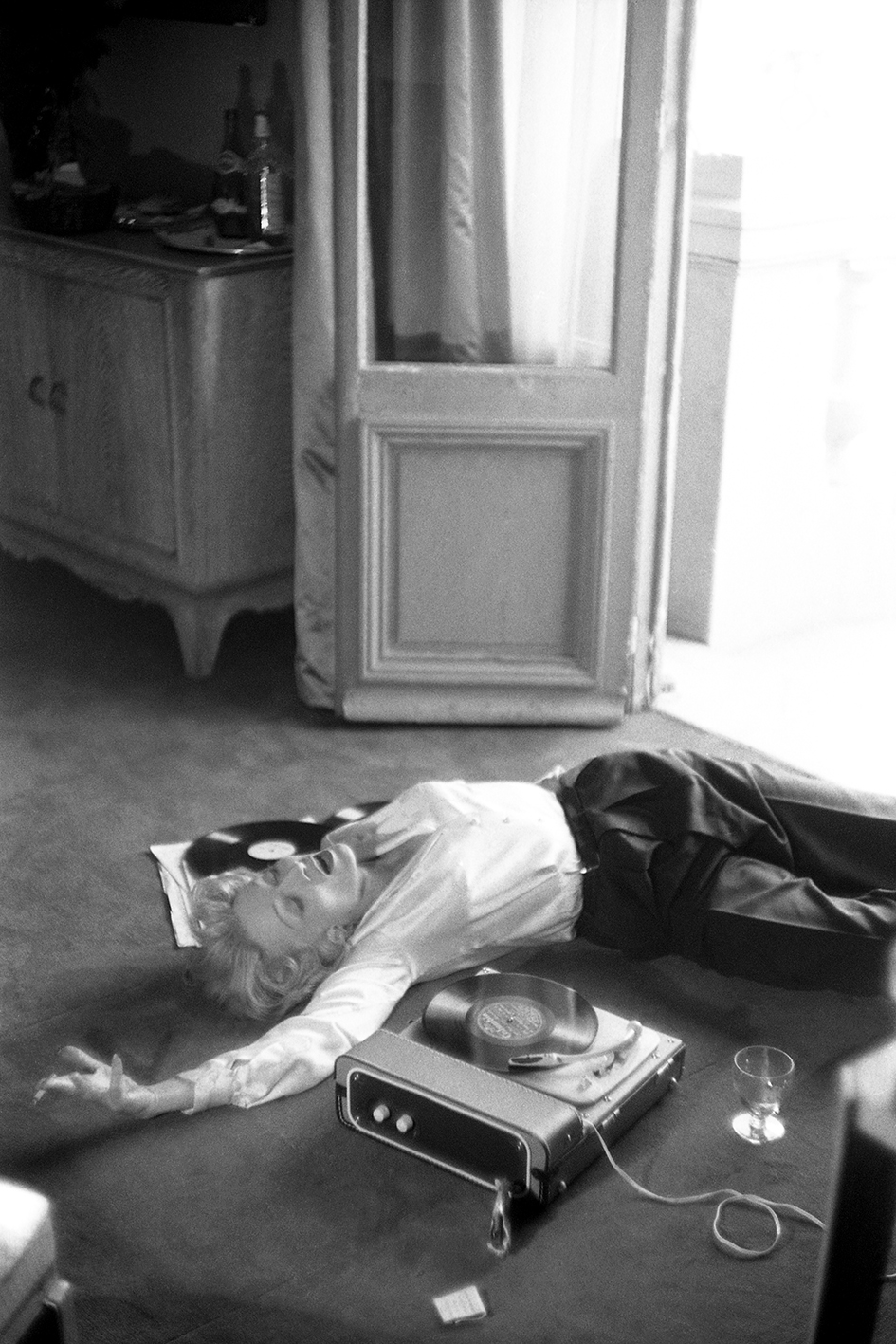 Marlène Dietrich lying on the floor, L'hotel de Paris, Monte Carlo, 1956