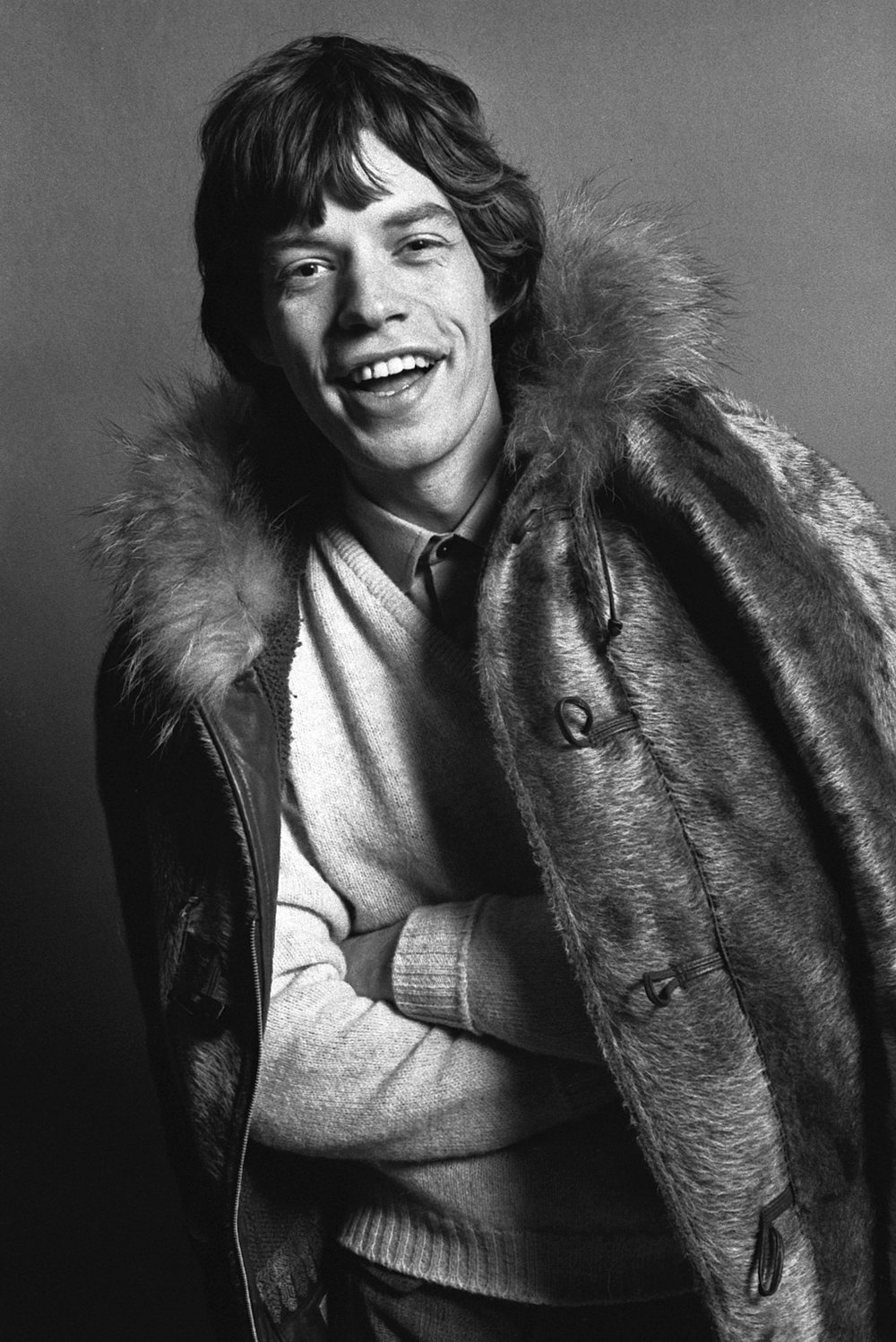 Mick Jagger Laughing wearing Fur Coat, c.1963