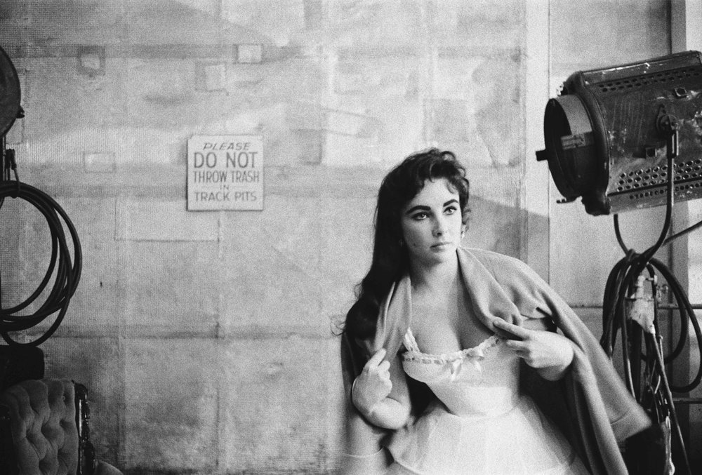 Elizabeth Taylor tries to keep warm on the set for Raintree County, 1965