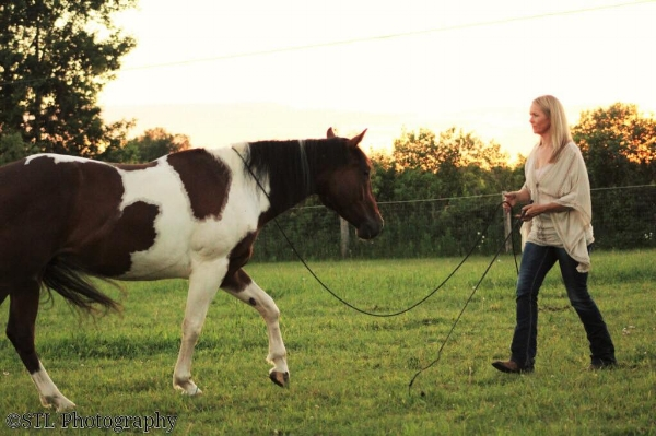 Lorie with Titan. Photo courtesy of @Lorie Duff Horsemanship