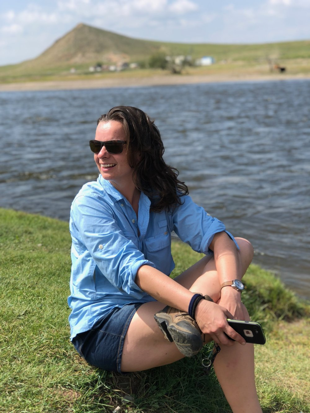 Ruth enjoying a pit stop by the river on the long trip from UB to base camp.