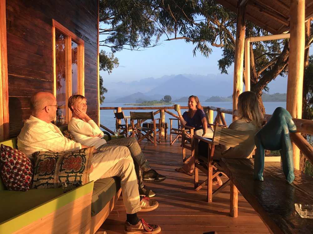 enjoy the view from our balcony as the sun rises behind the mountains and sets into the lake. we serve drinks at dusk and breakfast from dawn. -
