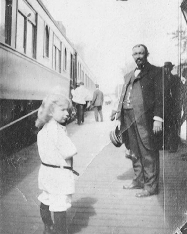 A young Lake Mary resident meets the train conductor as others board at the local station. The legacy of the railroad and connectivity of Central Florida plays an integral part in the past, present and future of Downtown  Lake Mary.