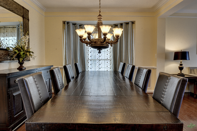 Long dining tablewith chandelier