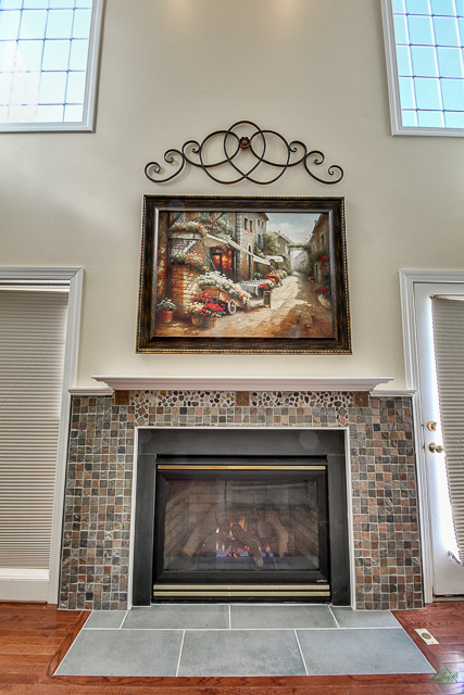 Fireplace below the painting