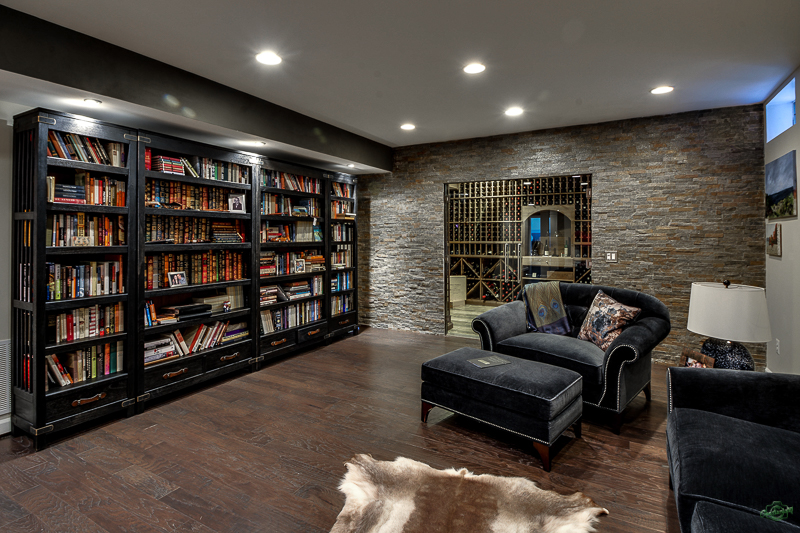 Home library with black couches