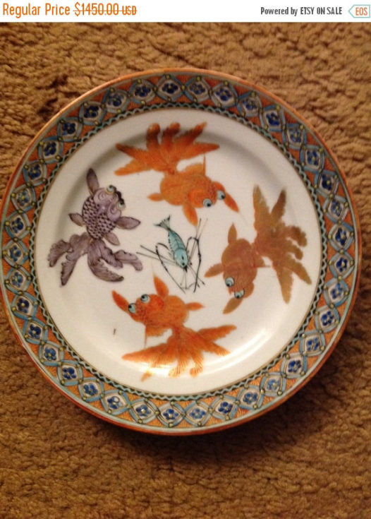 This guy is selling his last plate on Etsy, marked down by $100.00 from $1450.00 Mine has no mark on the white part of the plate.