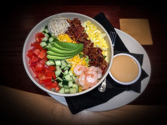 What's for lunch?? How about our Seafood Cobb! -Topped with seasoned shrimp, crab, bacon, avocado, tomato, egg, cucumber with pepper jack & cheddar cheeses with your choice of dressing- #chaeats #eatlocal #seafood #foodie