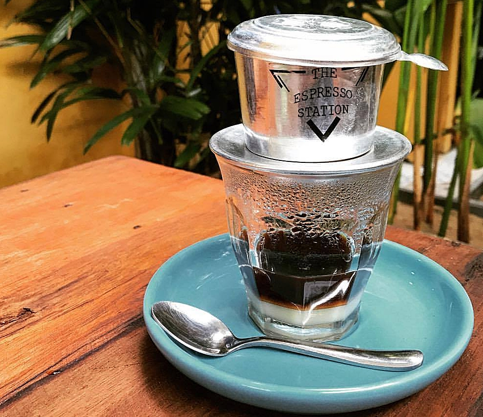"Vietnamese traditional phin - Ca phe sua Coffee is brewed in individual portion using ""phin""- a small metal Vietnamese drip filter, added with condensed milk. It's served hot or iced."