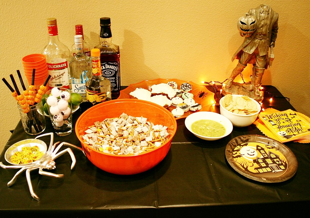 The full spread! All decor items (straws, eyeballs, serving dishes, paper plates, and napkins) were purchased at the Dollar Store. The spider candy dish is from the 99 Cent Store, and the Headless Horseman is from Ross.