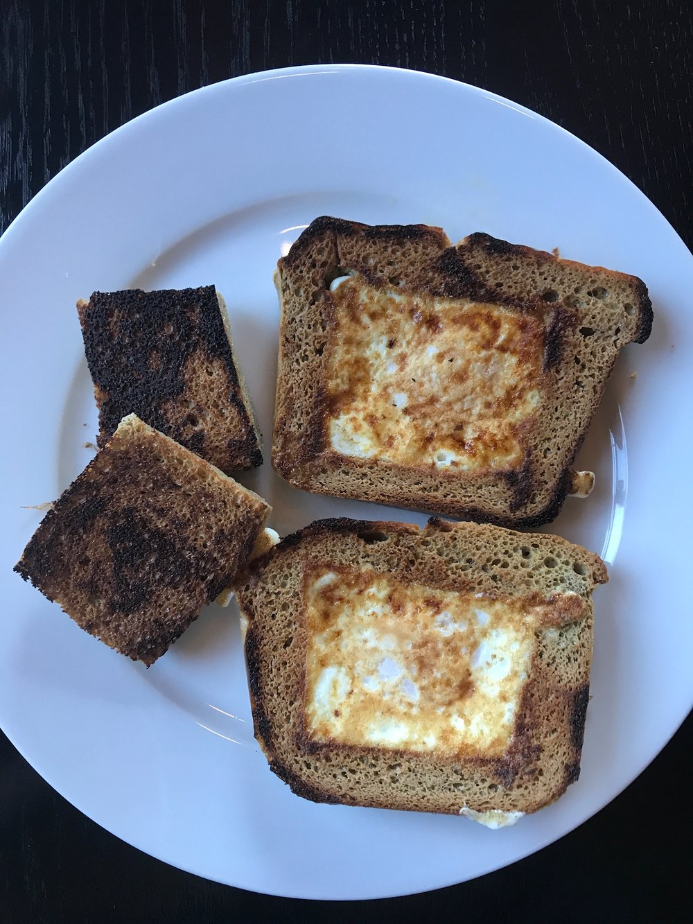 My mom's famous 'eggs in a basket'. This was a breakfast staple growing up in my family!