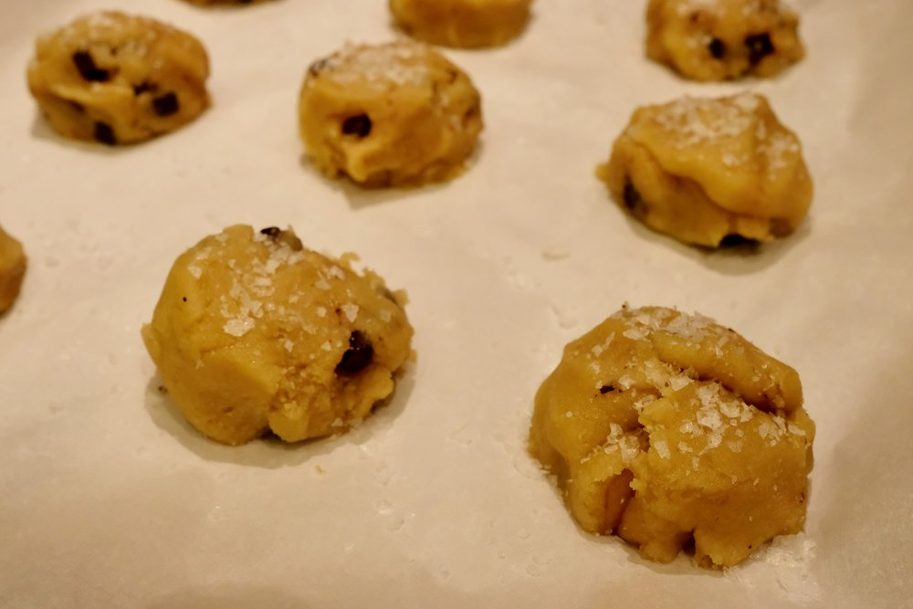 Form 12 balls of batter on the parchment paper and top with a generous amount of Maldon sea salt