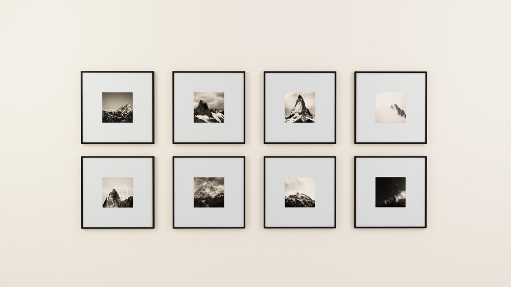 same themed black and white photos placed in the same size frame can alleviate long blank walls and feel well balanced.