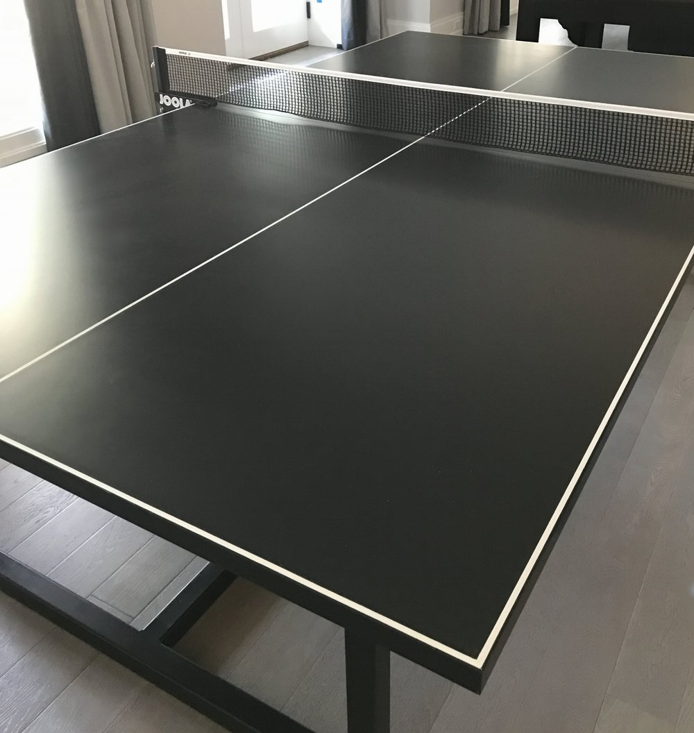 Charcoal and white ping pong table