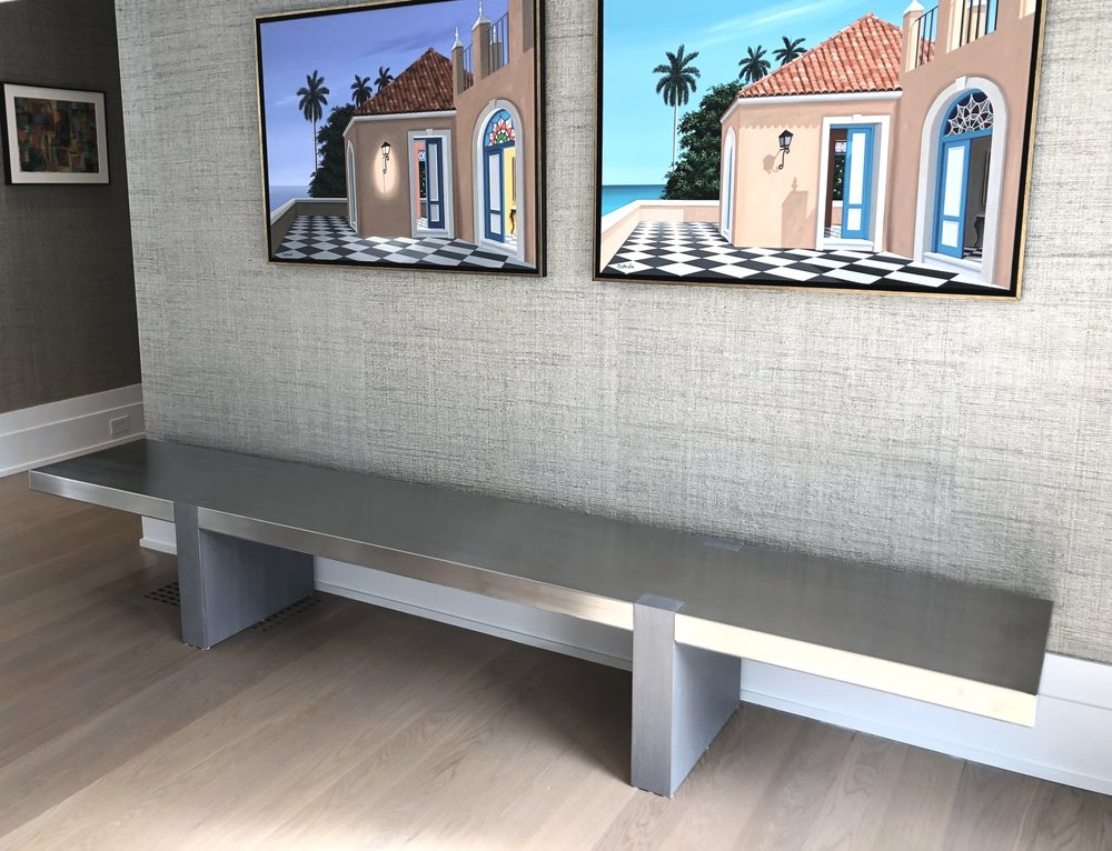 Stainless steel and white oak bench.