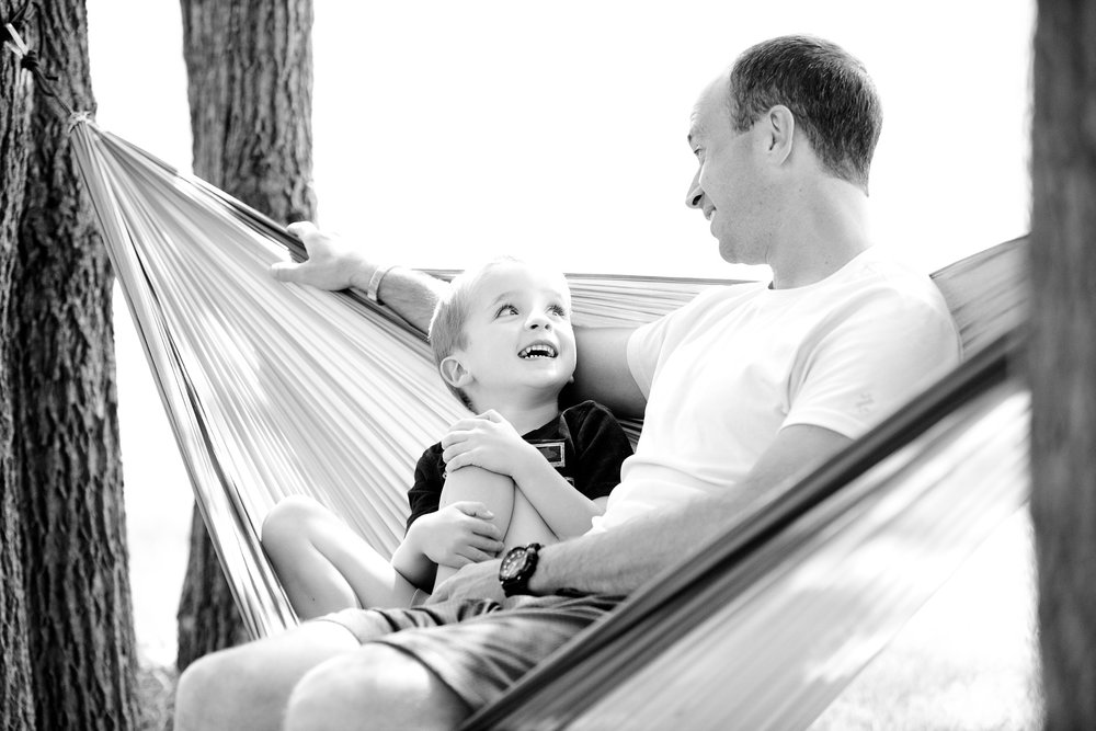dad and son on hammock