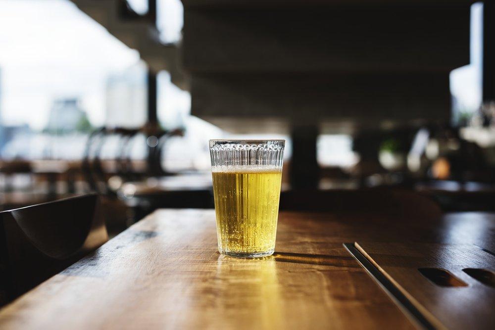 Glass of beer on bar.jpg
