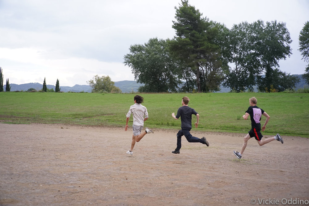 Ian, Matt, and Bill racing on the Olympic track.