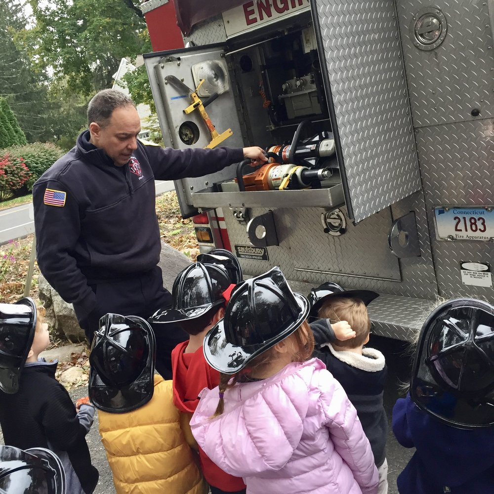 A Visit from the NC Fire Department - Thank you to the New Canaan Fire Department for coming out to teach us about fire safety and give us a tour of your fire engine. We were impressed by the size (and weight) of the warer hose, loved sitting in the driver's seat, and are grateful for the brave men who help to keep us all safe.