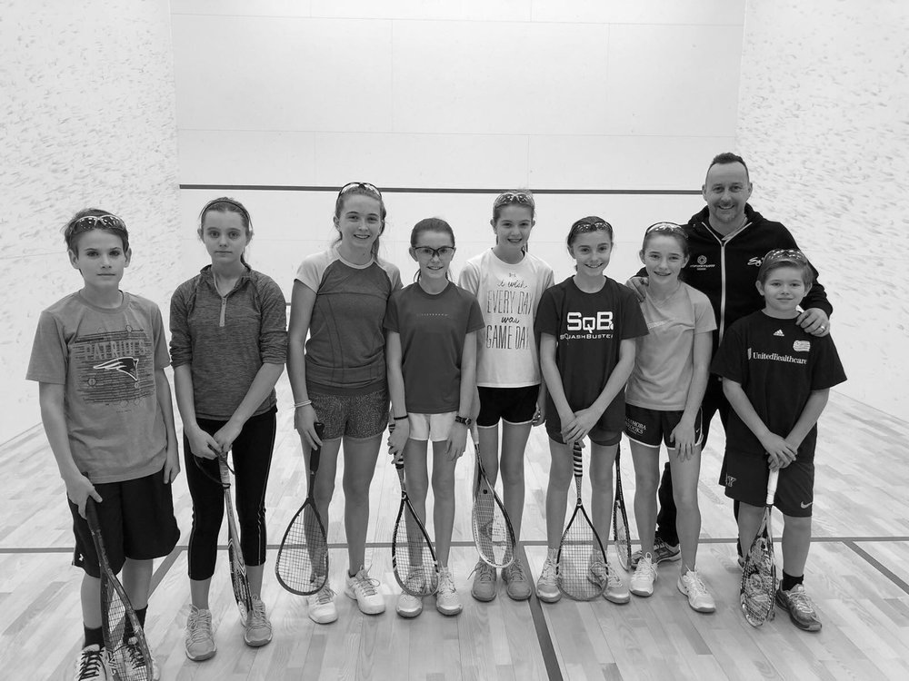 Nick Taylor with a group of junior squash athletes