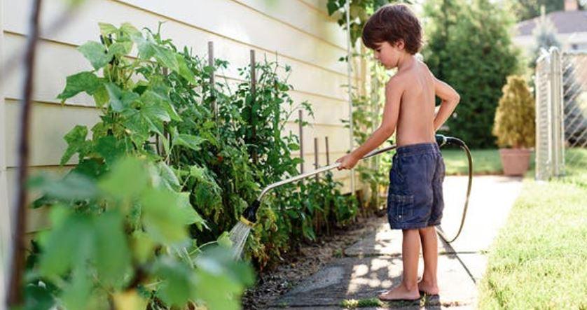 kid watering.JPG