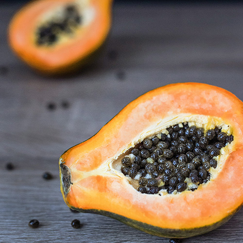 PAPAYA     Papaya carica   This tropical fruit is rich in vitamins A, C, E and K, and has antioxidant properties. It also contains magnesium, potassium, niacin, carotene, protein, fiber and an enzyme called papain that provides many health benefits.