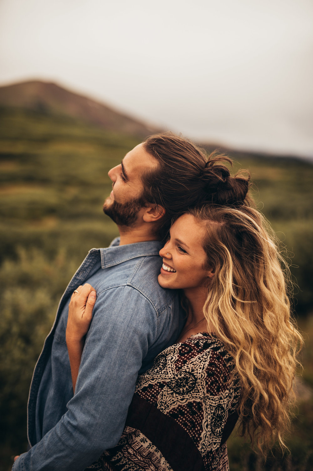 Woman Embracing Man From Behind In the Mountains