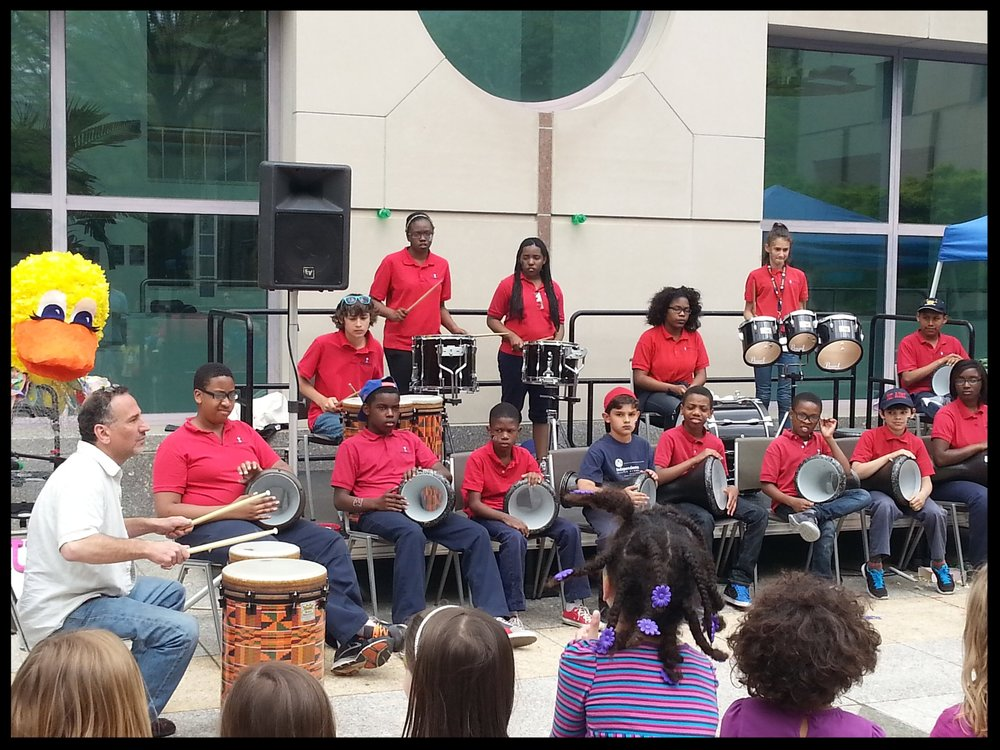 Students from Independence Charter School's World Drummers performing with Joe at the International Children's Festival.
