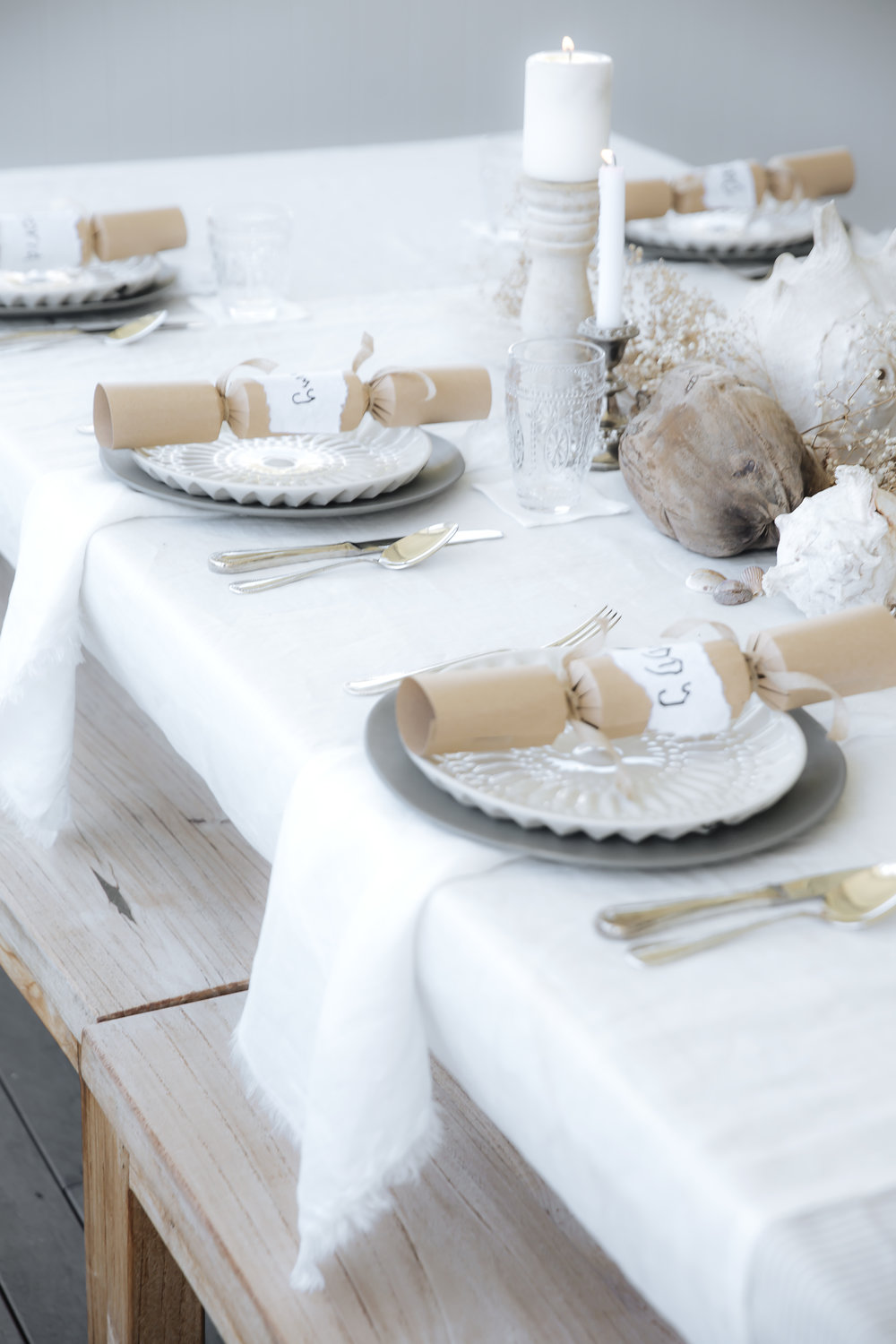 Linen Tablecloth in White, $89.00.Linen Napkins 4 pack in white, $49.00.
