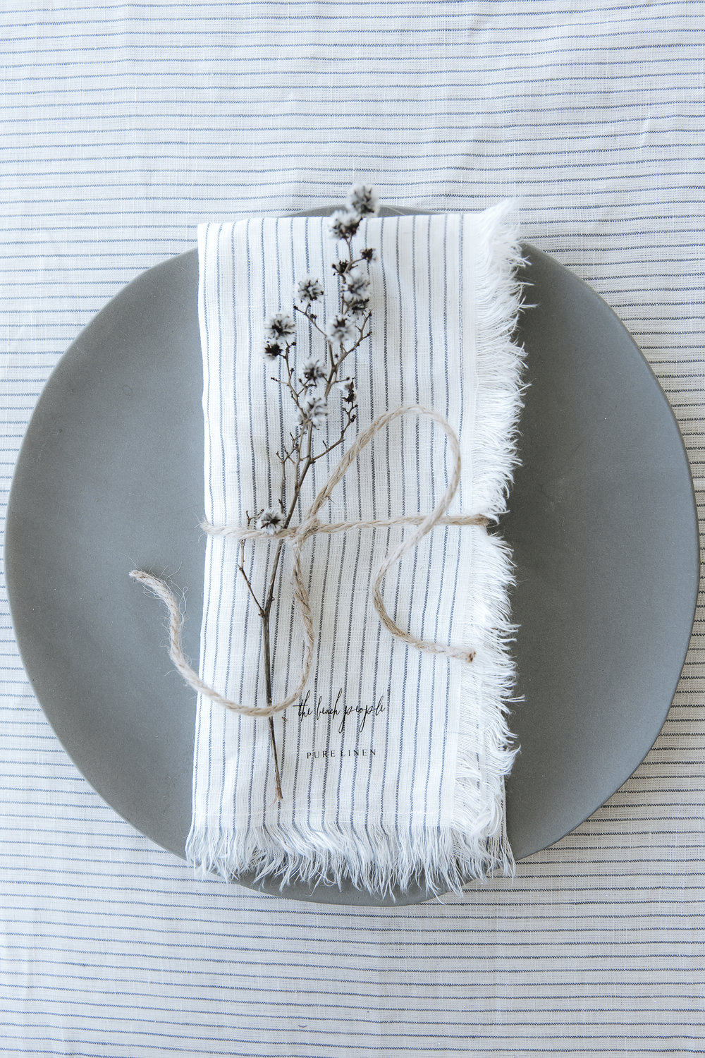 Linen Tablecloth in Stripe, $89.00. Linen Napkins 4 pack in Stripe, $49.00.