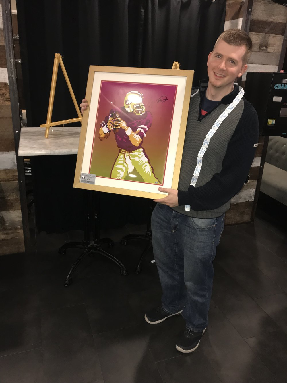 Not only did he win the tournament, he also walked away with the autographed Joe Montana Tecmo framed print.