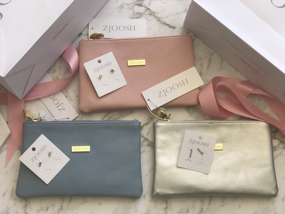 Zjoosh - Mama Mia clutch in pink, blue and silver worth $80 each.Three pairs of fine gold earrings valued at $75.