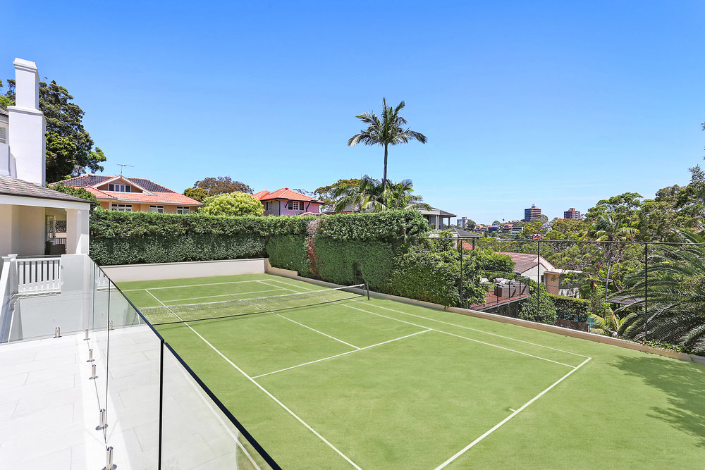 "A north-south facing championship tennis court, is just one of the spectacular features of ""Somers""."