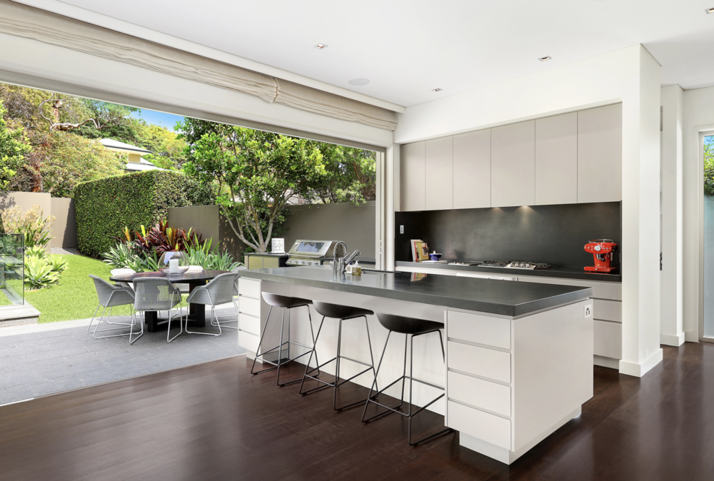 A stunning kitchen and entertaining area is a feature of 9 Plunkett Rd, Mosman.