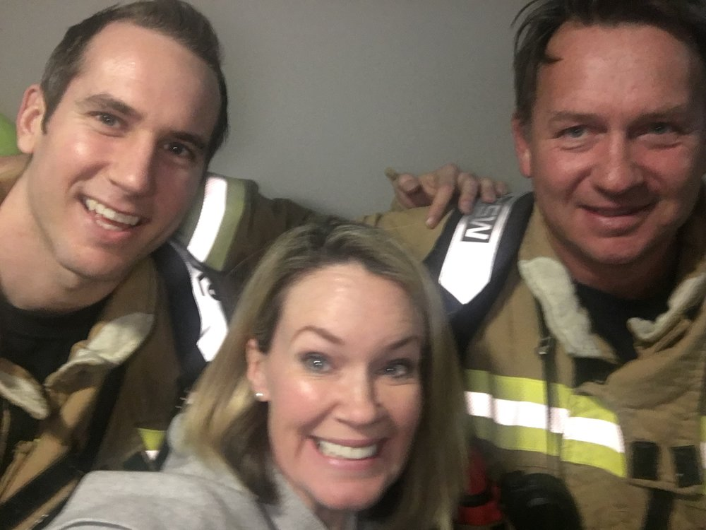 Fireys to the rescue: A relieved Anna Musson with Mosman fire fighters.