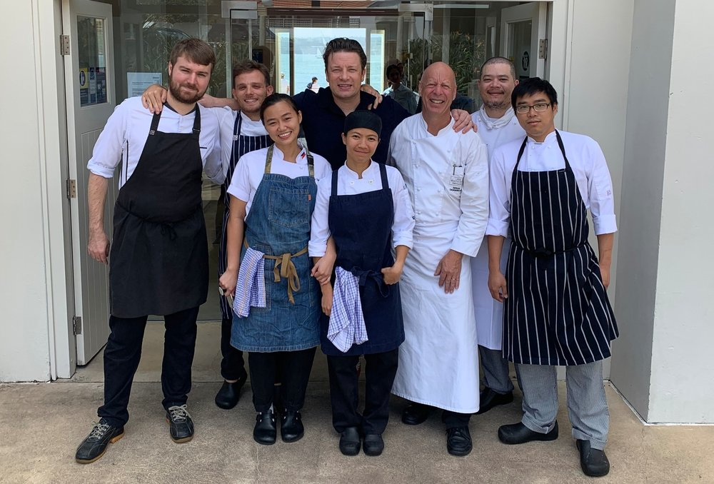 RELAXED: Jamie Oliver was happy to pose for a photo with Bathers Pavilion staff.