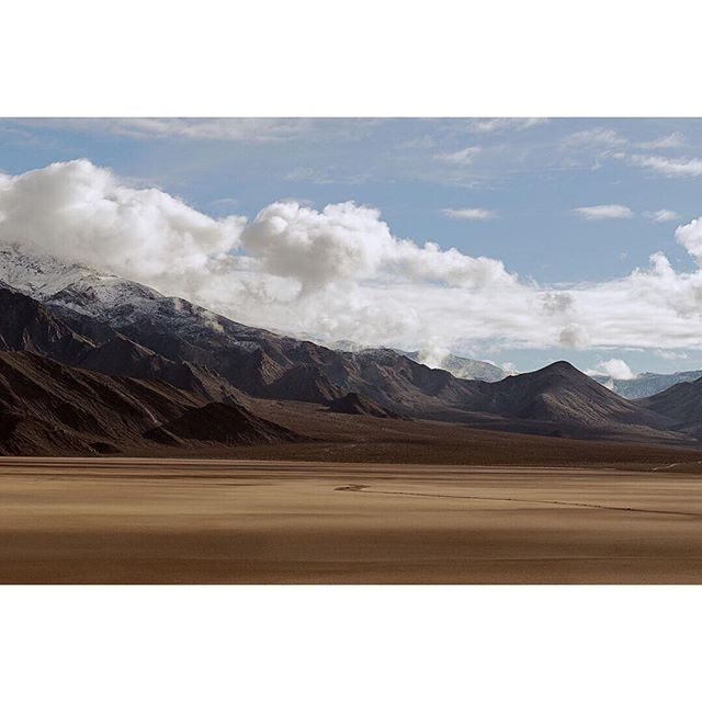 """Final Death Valley image for now. ⠀⠀⠀⠀⠀⠀⠀⠀⠀ I started reading a Japanese novel called Manazuru by Hiromi Kawakami. There is a sparse, distant, minimalism to the story which feels as isolated and disorienting as standing in these desert landscapes. ⠀⠀⠀⠀⠀⠀⠀⠀⠀ """"When the path ahead is still unformed, we lose all sense of our location."""" . . . . . #landscapephotography #landscape_lover #landscape_hunter #landscape_photography #landscapeporn #naturephotos #nature_photography #naturalbeauty #landscape_perfection #nature_lovers #deathvalley #deathvalleynationalpark #desertlandscape #drylake #otherworldly"""