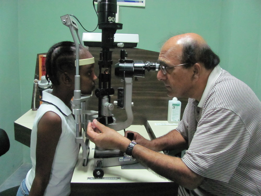 Dr. Lal with a patient in Haiti