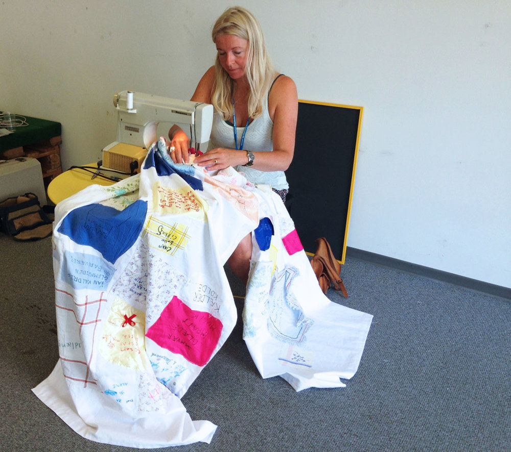 "Sewing all the pieces of textiles on the curtain.""From SPACE to PLACE to PARTICIPATION""AABENRAA ARTWEEK 2015 -"