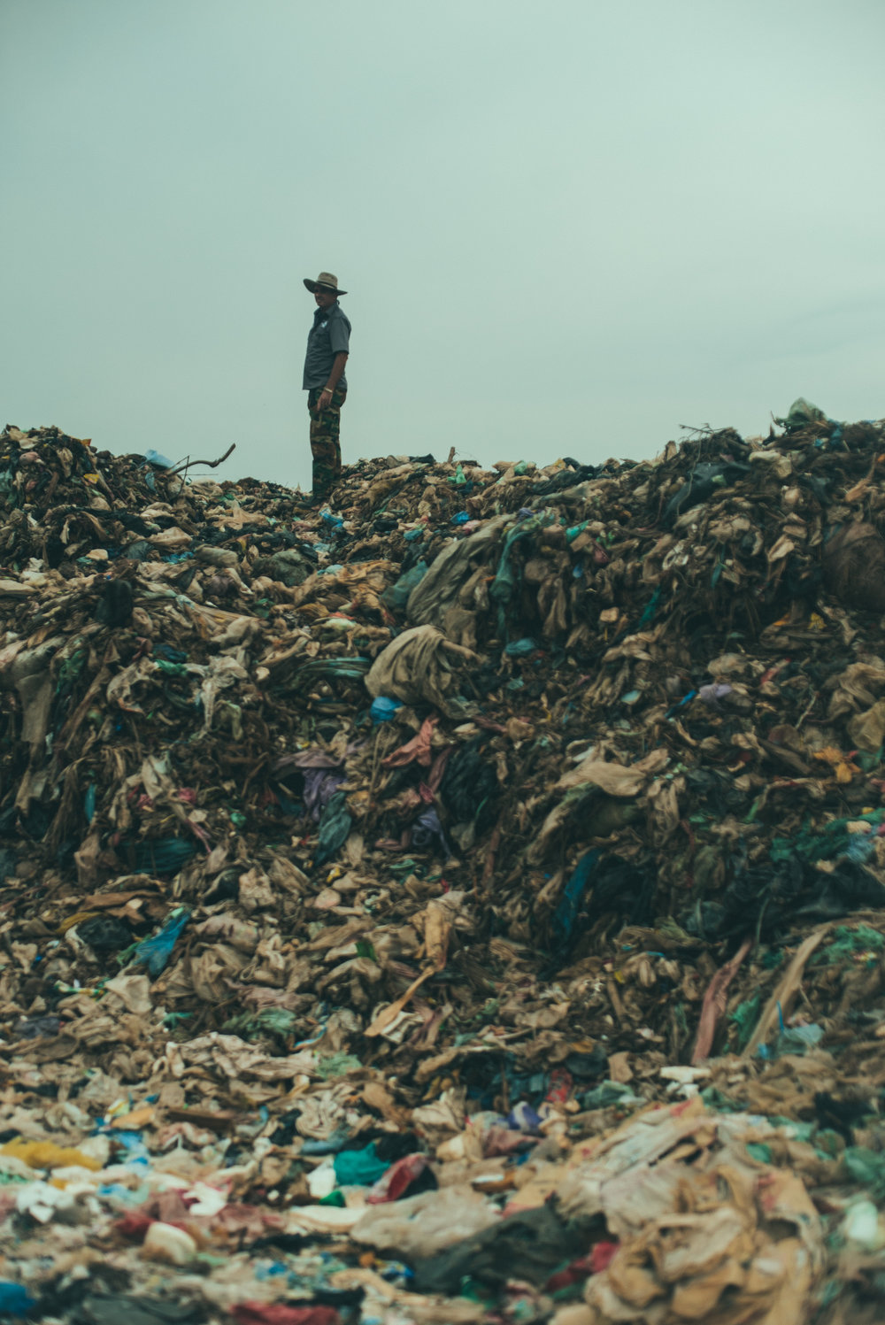 September 15th  - Yesterday, we visited a landfill in Siem Reap. Piles and piles of trash, stretching like an endless sea. Sandals, passport photocopies, plastic bags, forgotten stuffed animals, card decks, bras and all sorts of discarded every day use items, a sea of rubbish; and Jean Baptiste is standing on top of all pf that, a pioneer. However,  Jean Baptiste is not the only person in the landfill today, far from that. About 30 to 40 scavengers are crowding the site, cutting up scraps of vegetables and rotten fruits, collecting plastic bottles and iron pieces to sell to the Vietnamese. The scavengers live from our rubbish; they make three dollars a day. The work is dangerous for the pickers, the smells are toxic, the piles of trash are unstable; they walk in sandals among the broken shards. The methane gas blankets the landscape, the embodiment of an environmental grim reaper.