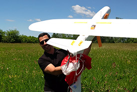 NCC staff Gary White holds the Areomapper Talon drone after a successful training run (Photo by NCC)