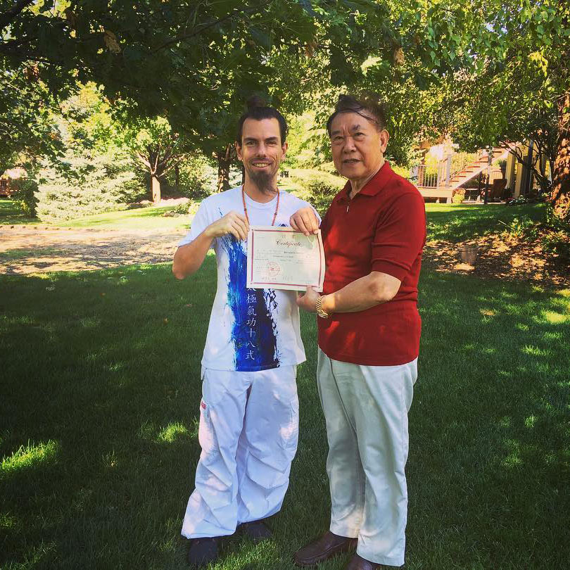 Fabrice Piché receiving his certification from Lin Housheng