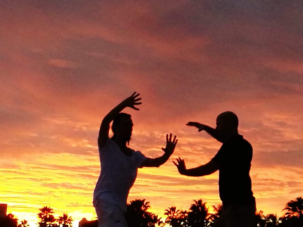 Qigong training on the beach at sunset!