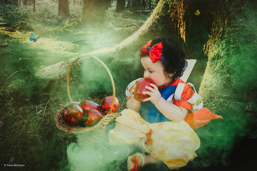 Gasp! Snow White is about to take a bite of the  magic wishing apple  that the old peddler woman (aka the Evil Queen) gave her!