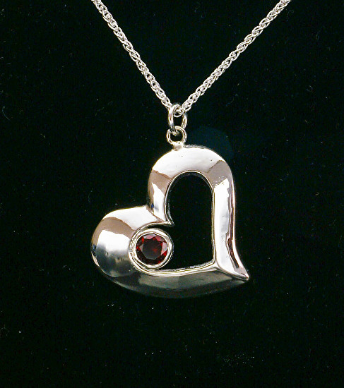 Ruby Set in Silver Heart